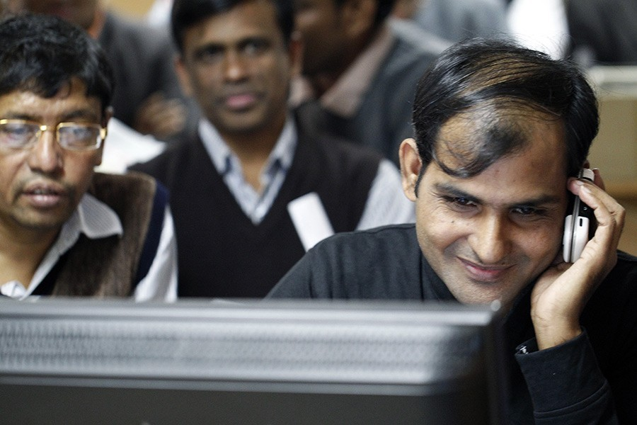 Investors react while monitoring stock price movements on computer screens at a brokerage house in the capital city — FE/Files