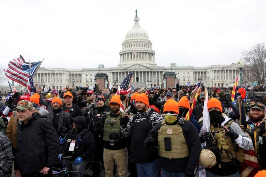 """Members of the far-right group Proud Boys make 'OK' hand gestures indicating """"white power"""" as supporters of US President Donald Trump gather in front of the US Capitol Building to protest against the certification of the 2020 US presidential election results by the US Congress, in Washington, US on January 6, 2021 — Reuters/Files"""
