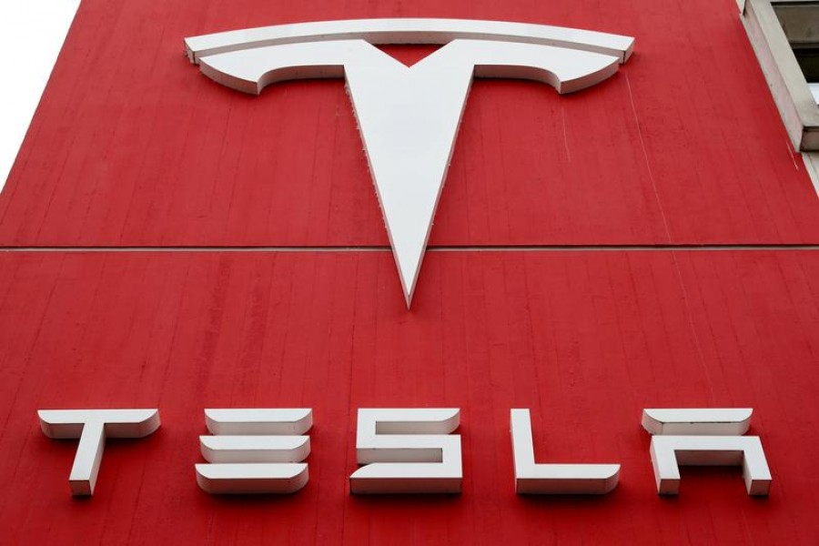 The logo of car manufacturer Tesla is seen at a branch office in Bern, Switzerland, October 28, 2020 — Reuters/Files