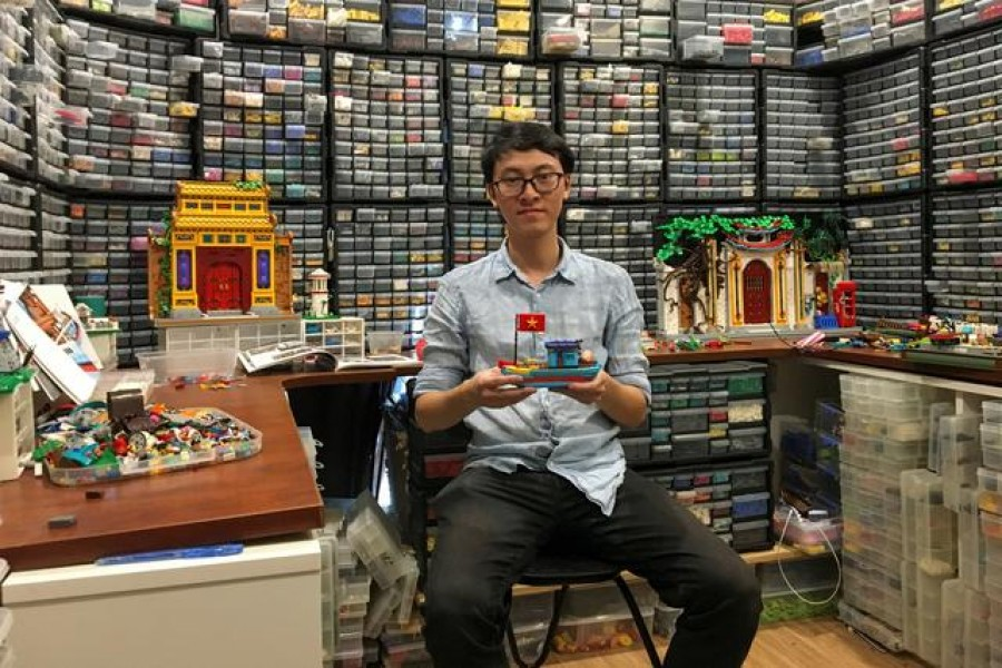 Hoang Dang, an industrial designer who loves Lego since he was a child poses in front of his pieces at his home in Hanoi, Vietnam March 13, 2021. REUTERS/Minh Nguyen