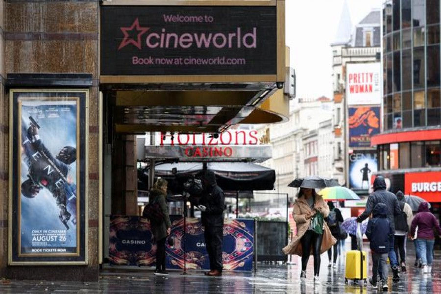FILE PHOTO: People walk past a Cineworld in Leicester's Square, amid the coronavirus disease (COVID-19) outbreak in London, Britain, October 4, 2020. REUTERS/Henry Nicholls/File Photo