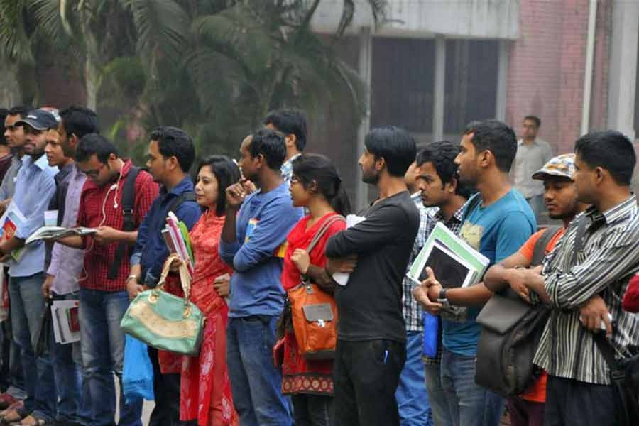A queue of youths is seen outside the Central Public Library in the capital city. Every day, thousands of students and job seekers use the library for their study and work —File photo