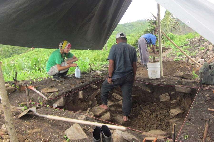 Amy Thompson speaks with members of the local community who worked with the team of researchers during excavations at the ancient Maya site of Uxbenka, Belize in April 2012 — Handout via Reuters