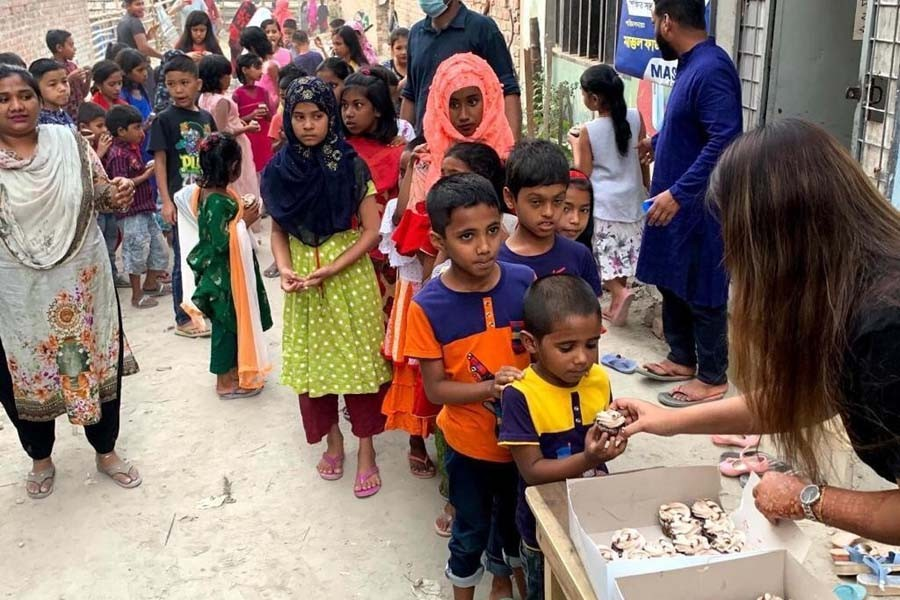 Poriborton Foundation distributing cupcakes among the underprivileged children at Rayer Bazar in the capital