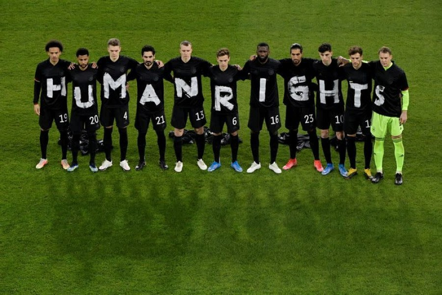 Germany players pose for a photo displaying a Human Rights message on their t-shirts before the match against Iceland on March 25, 2021 — Pool via Reuters