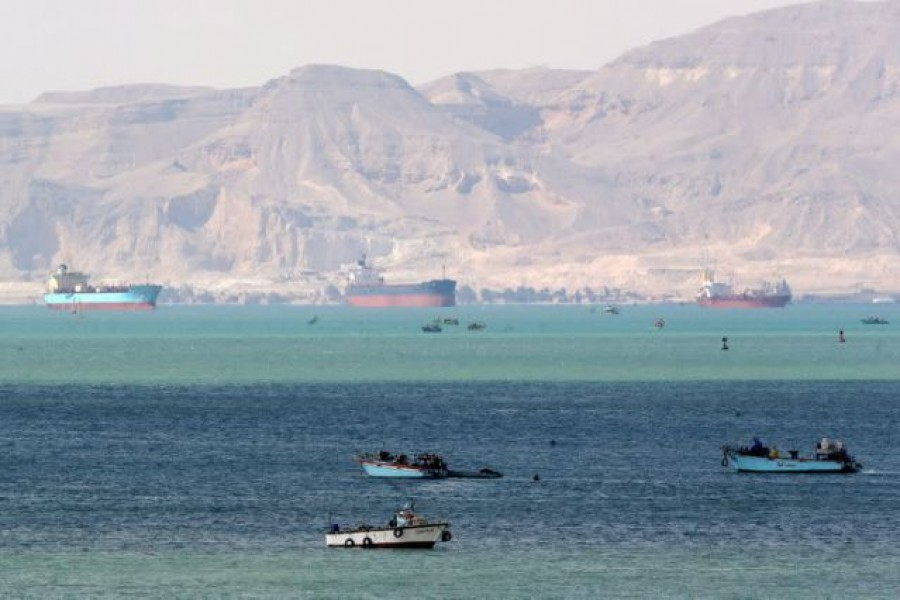 Ships and boats are seen at the entrance of Suez Canal, which was blocked by stranded container ship Ever Given that ran aground, Egypt on March 28, 2021 — Reuters photo
