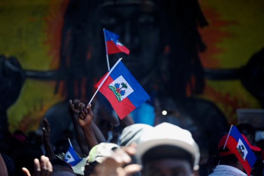 FILE PHOTO: Demonstrators hold Haiti's national flags during a protest against the government of President Jovenel Moise, in Port-au-Prince, Haiti March 28, 2021. REUTERS/Estailove ST-Val