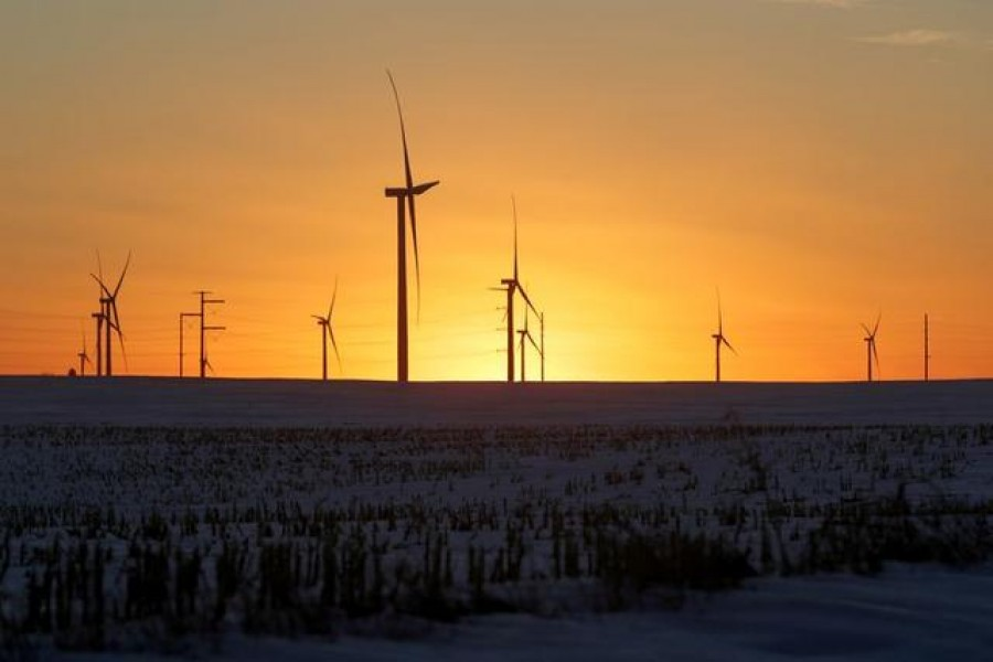 FILE PHOTO: A wind farm shares space with corn fields the day before the Iowa caucuses, where agriculture and clean energy are key issues, in Latimer, Iowa, US, February 2, 2020. REUTERS/Jonathan Ernst