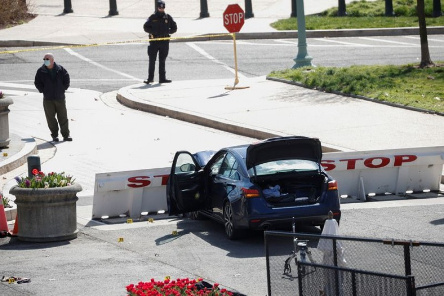 A blue car is seen after ramming a police barricade outside the US Capitol building in an incident that reportedly resulted in the death of one Capitol police officer, the injury of another officer and the death of the driver as a result of police gunfire on Capitol Hill in Washington, US, April 2, 2021. REUTERS/Tom Brenner