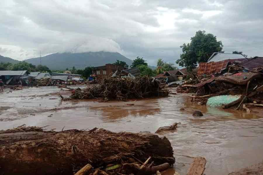 Damaged houses are seen at an area affected by flash floods after heavy rains in East Flores, East Nusa Tenggara province, Indonesia, on Sunday in this photo -Reuters photo