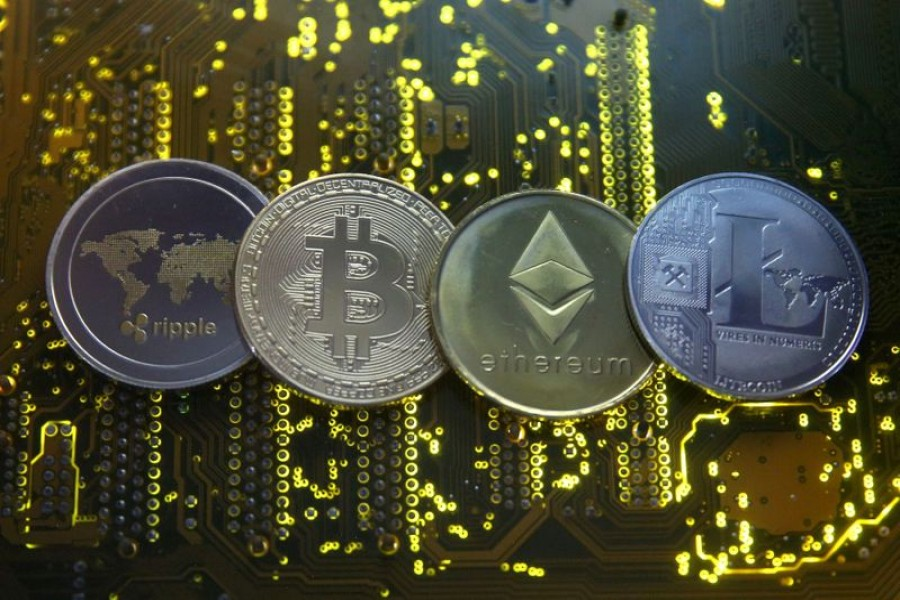 Representations of the Ripple, bitcoin, etherum and Litecoin virtual currencies are seen on a PC motherboard in this illustration picture on February 14, 2018 — Reuters/Files