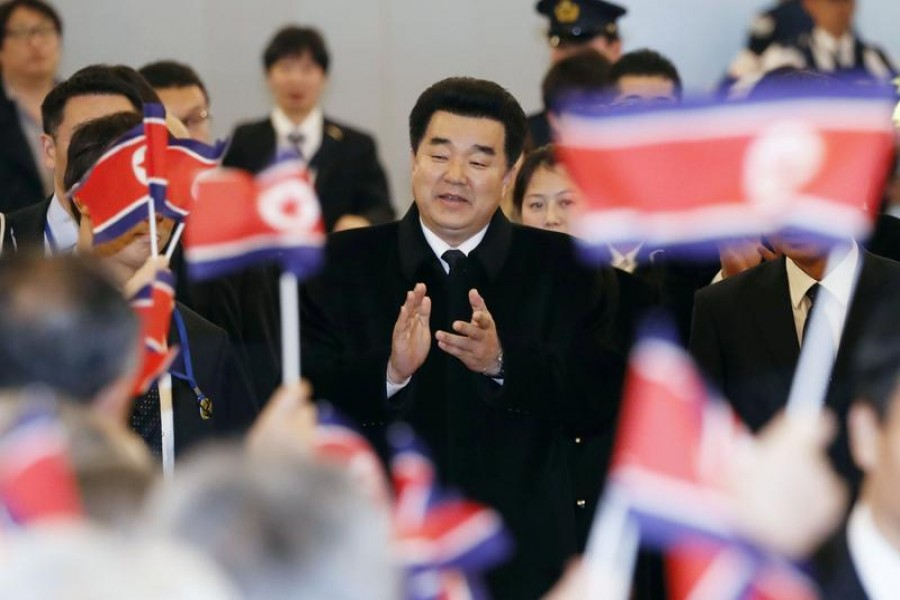 FILE PHOTO: Kim Il Guk, North Korea's sports minister and the president of the Olympic Committee of North Korea is greeted by North Korean residents in Japan upon his arrival at Tokyo's Haneda airport in Japan, in this photo taken by Kyodo November 27, 2018. Mandatory credit Kyodo/via REUTERS