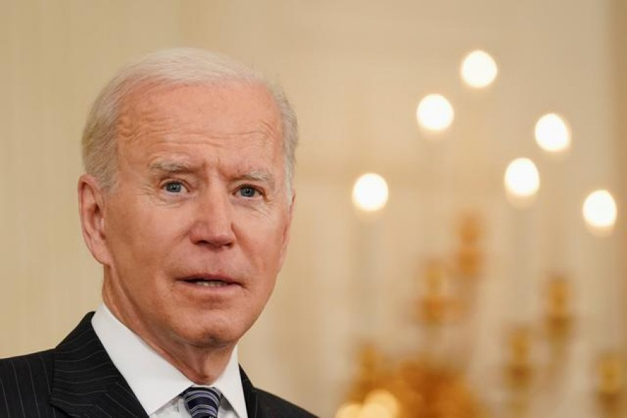 FILE PHOTO: US President Joe Biden delivers remarks on the state of the coronavirus disease (COVID-19) vaccinations from the State Dining Room at the White House in Washington, D.C., US, April 6, 2021. REUTERS/Kevin Lamarque