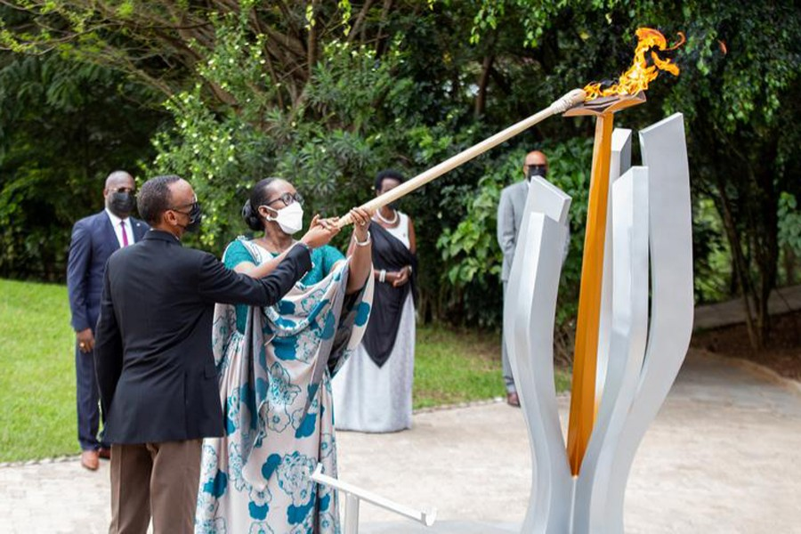 """Rwanda President Paul Kagame and first lady Jeanette Kagame light the Rwandan genocide flame of hope, known as the """"Kwibuka"""" (Remembering), to commemorate the 1994 Genocide, at the Kigali Genocide Memorial Center in Kigali, Rwanda on April 7, 2021 — Reuters photo"""