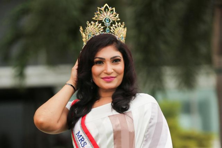 Pushpika De Silva poses for photographs with her Mrs Sri Lanka crown after it was forcibly removed by the reigning Mrs World, Caroline Jurie at the Mrs Sri Lanka contest, in Colombo, Sri Lanka, April 6, 2021. Picture taken April 6, 2021. REUTERS/Stringer