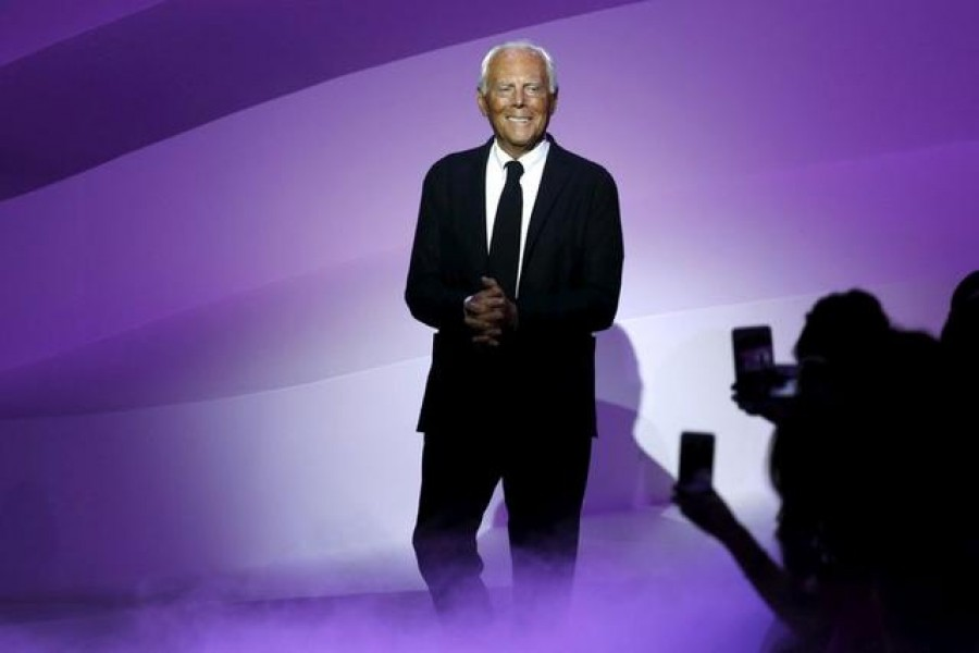 Italian designer Giorgio Armani appears at the end of his Haute Couture Spring/Summer 2016 fashion show for Giorgio Armani Prive in Paris, France, January 26, 2016. REUTERS/Benoit Tessier/File Photo