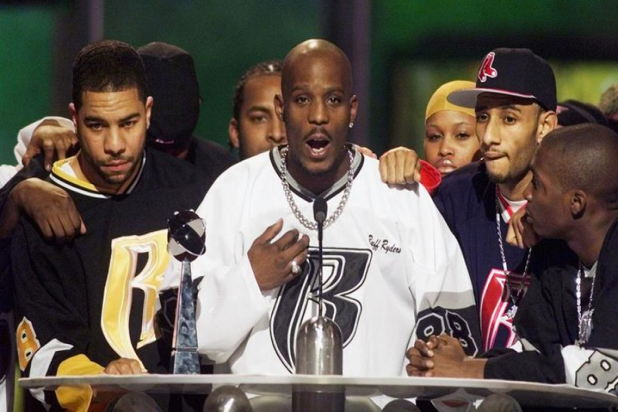 FILE PHOTO: Rapper DMX (C) offers a prayer after winning the R&B Albums Artist of the Year award at the Billboard Music Awards show at the MGM Grand Hotel in Las Vegas December 8, 1999. REUTERS/Ethan Miller/File Photo