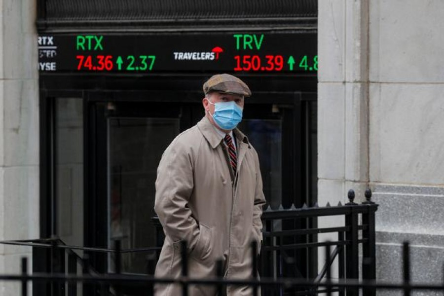 A trader exits the New York Stock Exchange (NYSE) after the trading day in New York, U.S., March 1, 2021. REUTERS/Brendan McDermid