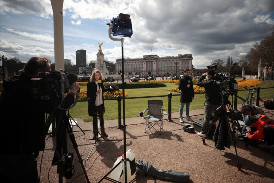 Members of the media report outside Buckingham Palace after it was announced that Britain's Prince Philip, husband of Queen Elizabeth, has died at the age of 99, in London, Britain, April 9, 2021 — Reuters