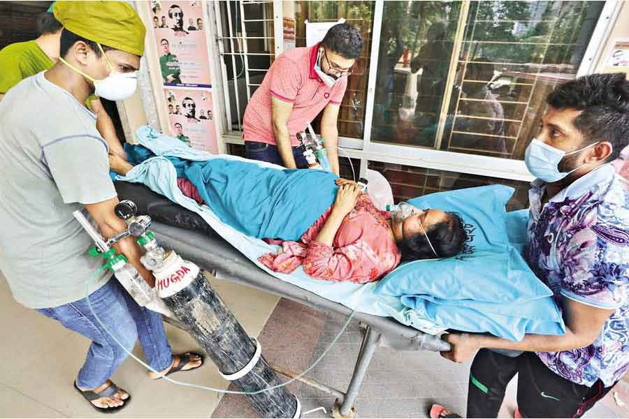 No ICU bed was available for Minara Begum, a critical Covid-19 patient, at Dhaka Medical College Hospital where she works as a nursing supervisor. Finally, she was shifted to Mugda General Hospital where an ICU bed was arranged for her — FE photo by KAZ Sumon