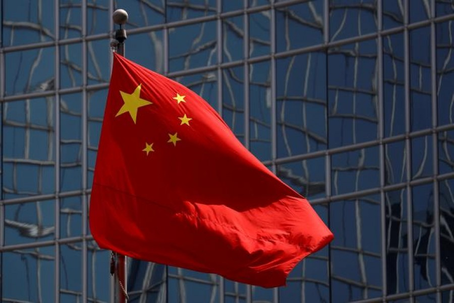 The Chinese national flag is seen in Beijing, China April 29, 2020. REUTERS/Thomas Peter/File Photo/File Photo
