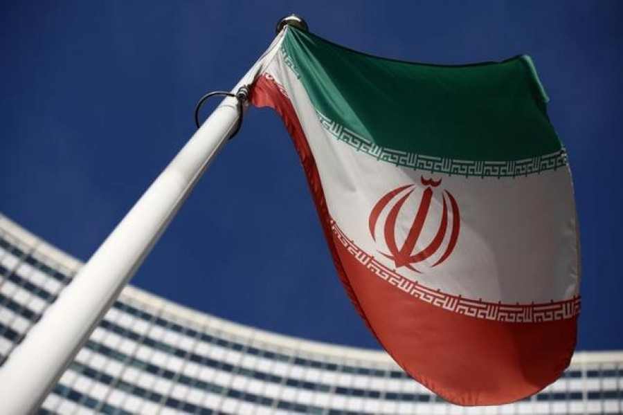 The Iranian flag waves in front of the International Atomic Energy Agency (IAEA) headquarters, before the beginning of a board of governors meeting, amid the coronavirus disease (COVID-19) outbreak in Vienna, Austria, March 1, 2021. REUTERS/Lisi Niesner/File Photo