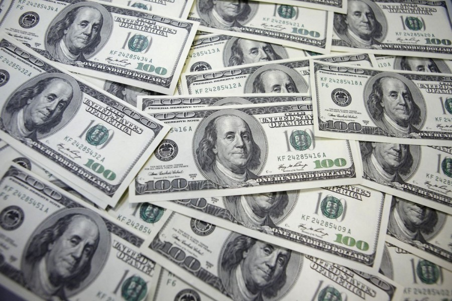 US 100 dollar notes are seen at a bank in this picture illustration — Reuters