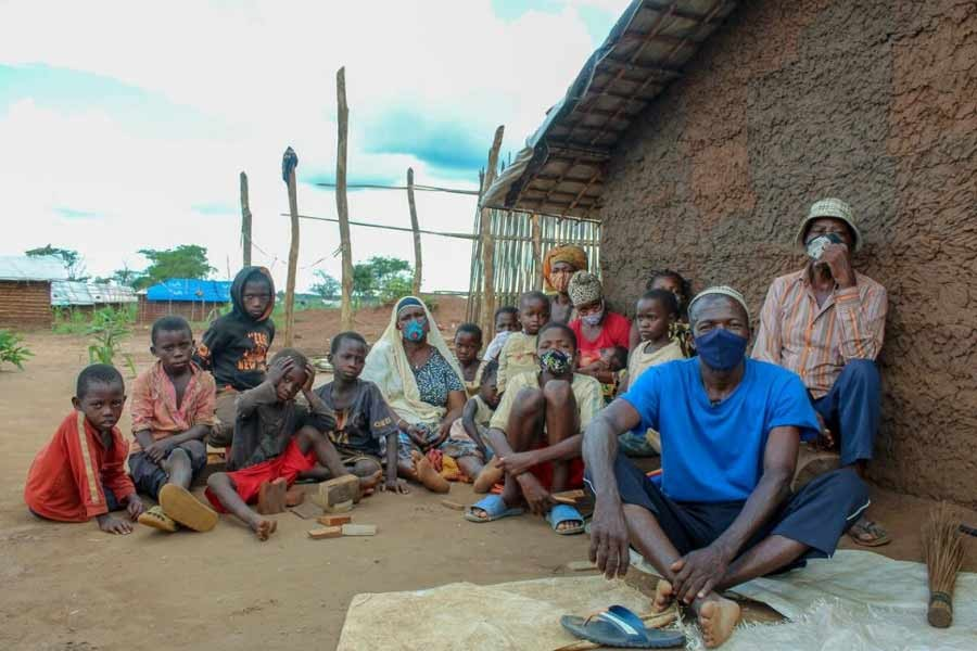 Herculano, 64 (in blue t-shirt) fled violence in Quissanga District in Cabo Delgado, with his whole family, including children and grandchildren -UNHCR photo