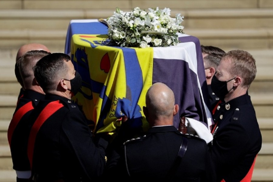 The coffin of Britain's Prince Philip, husband of Queen Elizabeth, who died at the age of 99, is taken into St George's Chapel for a funeral service, in Windsor, Britain, Apr 17, 2021. REUTERS