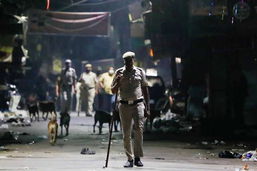 A police officer patrols on a deserted street during a curfew to limit the spread of the coronavirus disease (COVID-19), in New Delhi, India, Apr 6, 2021. REUTERS