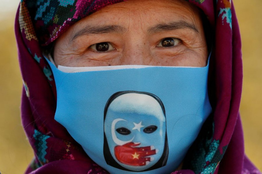 An Ethnic Uighur demonstrator wearing a protective face mask takes part in a protest against China, in Istanbul, Turkey on October 1, 2020 — Reuters/Files