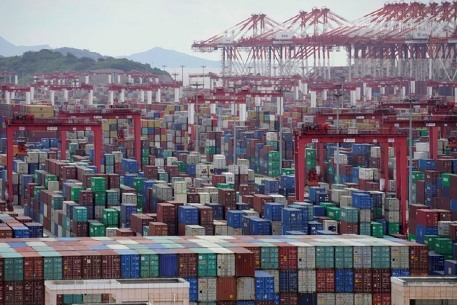 Containers are seen at the Yangshan Deep-Water Port in Shanghai, China, October 19, 2020 — Reuters/Files