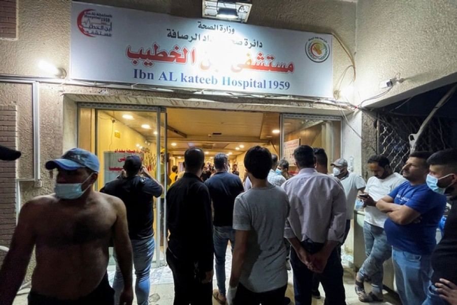 People gather at Ibn Khatib hospital after a fire caused by an oxygen tank explosion in Baghdad, Iraq, April 25, 2021. REUTERS
