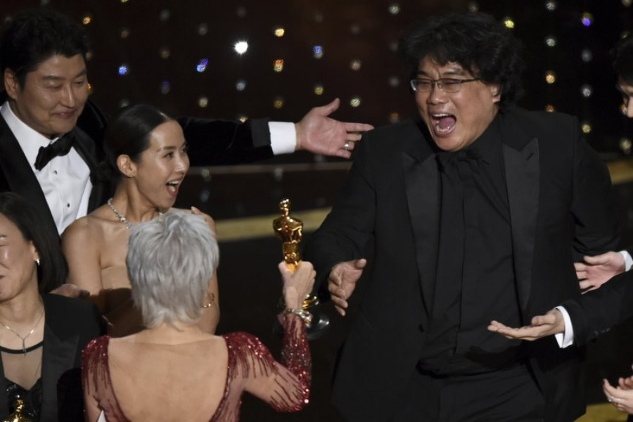 Bong Joon Ho, right, reacts as he is presented with the award for best picture for 'Parasite' from presenter Jane Fonda at the Oscars, February 09, 2020, at the Dolby Theatre in Los Angeles — AP Photo/Files