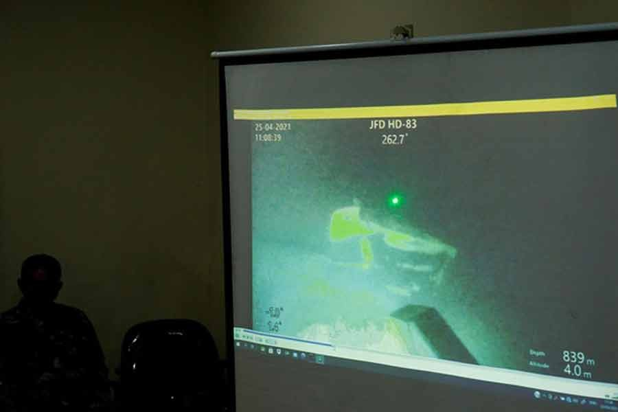 The military personnel displaying a video showing what is believed to be the sunken Indonesian Navy KRI Nanggala-402 submarine during a media conference at I Gusti Ngurah Rai Airport in Indonesia on Sunday -Reuters photo