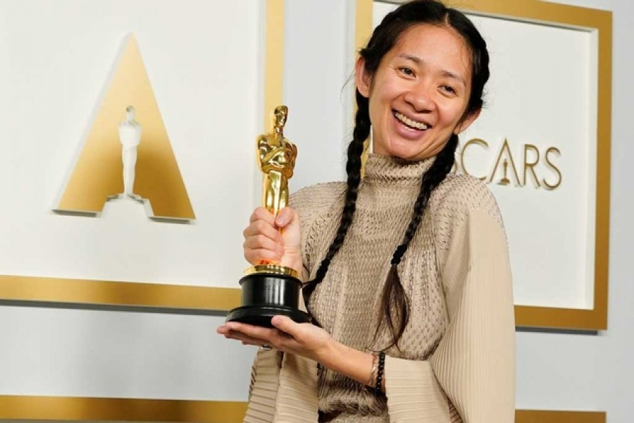 "Director/Producer Chloe Zhao, winner of the award for best picture for ""Nomadland,"" poses in the press room at the Oscars in Los Angeles, California, US,  April 25, 2021. REUTERS"