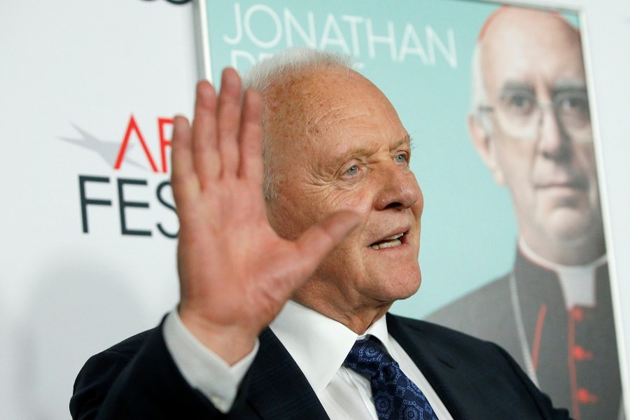 """Cast member Anthony Hopkins waves at a premiere for the film """"The Two Popes"""" during AFI Fest 2019 in Los Angeles, California, US, November 18, 2019 — Reuters"""