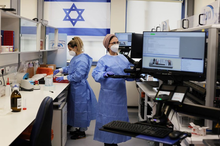 Technicians work at Healthcare Maintenance Organization (HMO) Maccabi's coronavirus disease (Covid-19) public laboratory, performing diverse and numerous tests, in Rehovot, Israel on February 9, 2021 — Reuters/Files