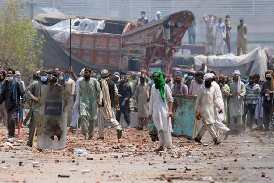 Supporters of the banned Islamist political party Tehrik-e-Labaik Pakistan (TLP) with sticks and stones block a road during a protest in Lahore of Pakistan on April 18 this year -Reuters file photo