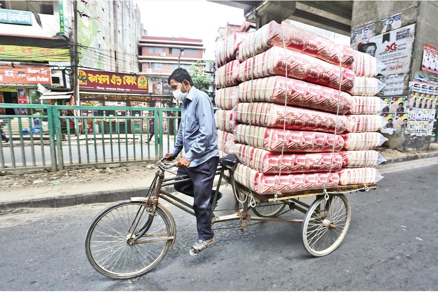 A rickshaw van carrying puffed rice (muri) from a factory to retailers in Jatrabari area of the city on Friday. The demand for puffed rice, an obvious item for Iftar of the Bangladeshis, usually increases during Ramadan — FE photo KAZ Sumon