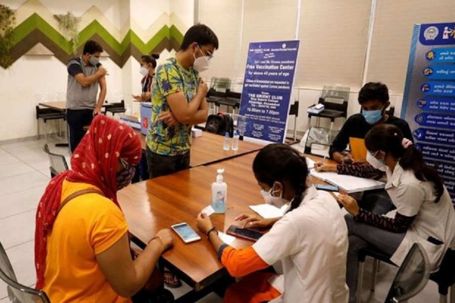 People get their names registered after receiving a dose of COVISHIELD, a coronavirus disease (COVID-19) vaccine manufactured by Serum Institute of India, at a vaccination centre in Ahmedabad, India, May 1, 2021. REUTERS