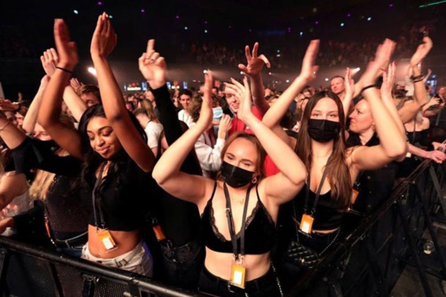 People attend a music event at Ziggo Dome venue, which opened its doors to small groups of people that have been tested negative of the coronavirus disease (COVID-19) in Amsterdam, Netherlands March 6, 2021. REUTERS