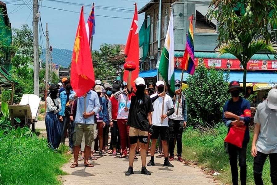 Demonstrators carry flags as they march to protest against the military coup, in Dawei, Myanmar, April 27, 2021 — Courtesy of Dawei Watch/via Reuters