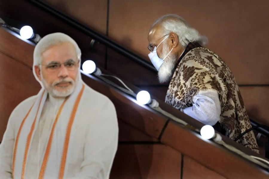 In this Nov. 11 2020, file photo, Indian Prime Minister Narendra Modi leaves after a function at the Bharatiya Janata Party headquarters following a state election in New Delhi, India. Despite clear signs that India was being swamped by another surge of coronavirus infections, Modi refused to cancel campaign rallies, a major Hindu festival and cricket matches with spectators - AP Photo/Manish Swarup, File