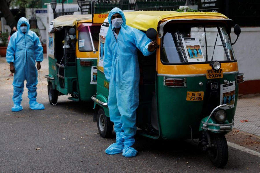 Drivers stand near auto rickshaw ambulances, prepared to transfer people suffering from the coronavirus disease (COVID-19) and their relatives for free, in New Delhi, India May 5, 2021. Picture taken May 5, 2021. REUTERS/Adnan Abidi