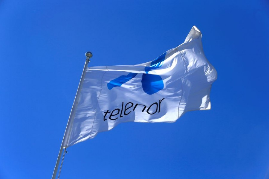 Telenor flag flutters next to the company's headquarters in Fornebu, Norway on June 1, 2017 — Reuters/Files