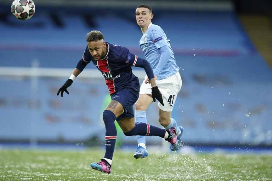 Manchester City's Phil Foden, right, challenges PSG's Neymar during the Champions League semifinal second leg soccer match between Manchester City and Paris Saint Germain at the Etihad stadium, in Manchester on May 4 -AP Photo