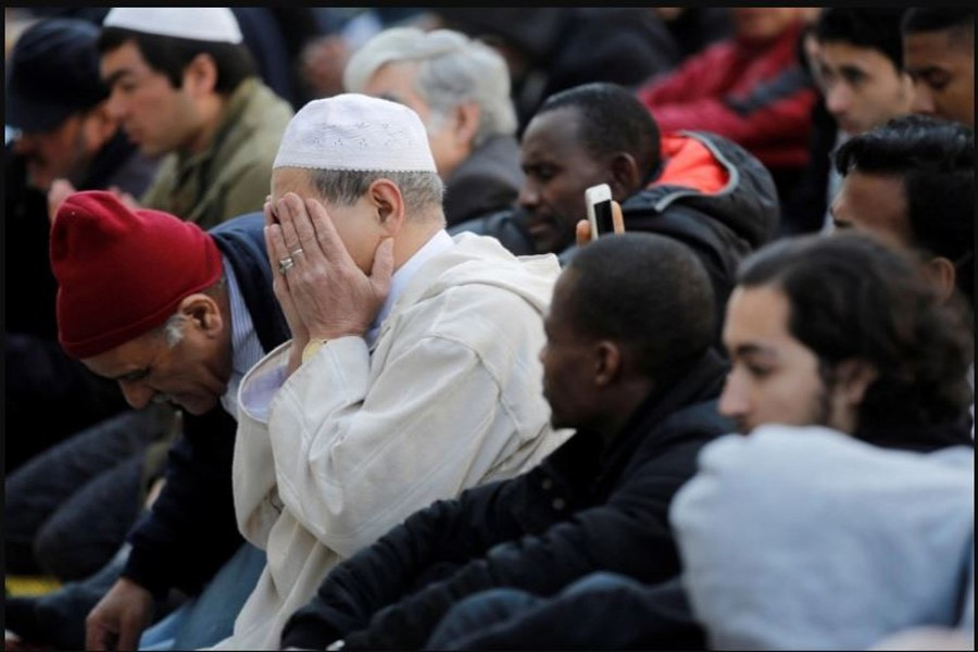 Muslims pray during Friday prayers in the street in front of the city hall of Clichy, near Paris, France, April 21, 2017 (File: Benoit Tessier/Reuters)