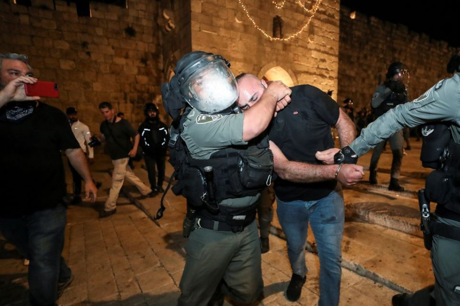 Israeli police detain a Palestinian at Jerusalem's Old City during clashes, as the Muslim holy fasting month of Ramadan continues, in Jerusalem April 24, 2021. REUTERS/ Ammar Awad