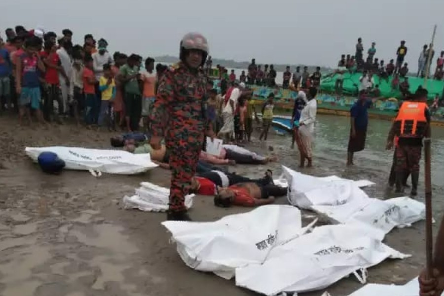 A speedboat is seen ashore after it collided with a sand-laden bulk carrier and sank on Padma River, in Madaripur, Bangladesh, May 3, 2021 — Reuters